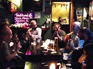 Friday night at the Bridge Bar, Bundoran. Our host Connie, buxom bloke in blue checked shirt on a mean guitar