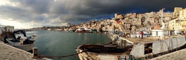 Dark afternoon - fishing boats return to Sciacca.port